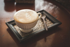Hot coffee in the coffee shop, vintage color filter. Royalty Free Stock Photos