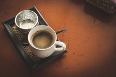 Hot coffee in the coffee shop, vintage color filter. Royalty Free Stock Images