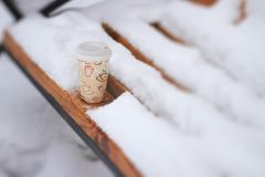 Hot coffee in cold winter day outdoors Royalty Free Stock Photos