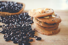 Hot coffee and cookie. On the table Royalty Free Stock Photos