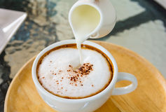 Hot coffee with cream. Stock Photos
