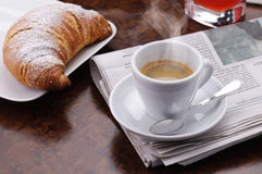 Hot coffee with croissant Stock Images