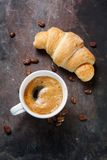 Hot coffee and a croissant Stock Images