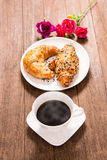 Hot coffee and croissant Royalty Free Stock Photos