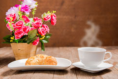 Hot coffee and croissant Royalty Free Stock Images
