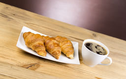 Hot coffee with croissants Stock Image