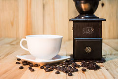 Hot coffee cup and bean on wood background vintage tone Royalty Free Stock Photo