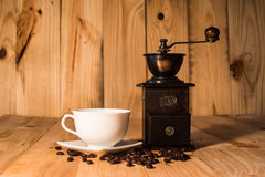 Hot coffee cup and bean on wood background vintage tone Stock Photography