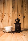 Hot coffee cup and bean on wood background vintage tone Stock Images