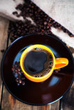 Hot coffee. Cup of hot coffee with coffee beans on wooden background Royalty Free Stock Images