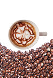 Hot coffee cup with clipping path and coffee beans top view on w Royalty Free Stock Image