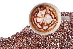Hot coffee cup with clipping path and coffee beans top view on w Stock Images