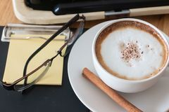 Hot coffee in cup and coffee bean and typewriter stock images