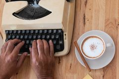 hot coffee in cup and coffee bean and typewriter stock photography