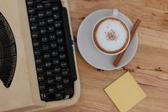 Hot coffee in cup and coffee bean and typewriter stock photo