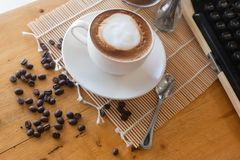 Hot coffee in cup and coffee bean and typewriter stock photos