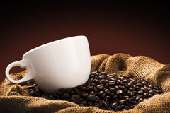 Hot Coffee Cup on Coffee Beans Royalty Free Stock Images