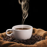 Hot Coffee Cup on Coffee Beans Stock Image