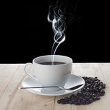 Hot Coffee Cup on Coffee Beans Stock Photography