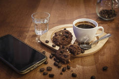 Hot coffee on cup and cookie on table in cafe Stock Images