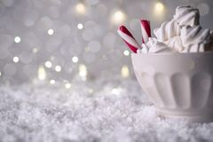 Hot Coffee cup with marshmallows and red candy cane on a frosty winter background. Christmas holidays background. stock image
