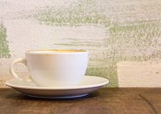 Hot coffee in a cup on table Royalty Free Stock Images