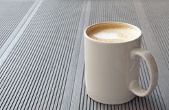 Hot coffee cup on a table Stock Photos