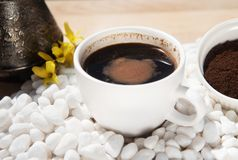 Hot coffee in a cup on a white stone Royalty Free Stock Images