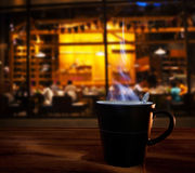 Hot coffee cup on wood table in coffee cafe shop use for food an Royalty Free Stock Images