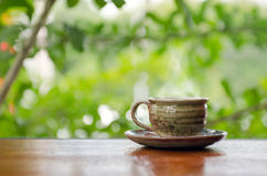 Hot coffee cup on the wooden table in coffee shop Stock Image