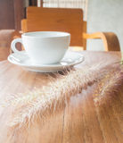 Hot coffee cup on wooden table Royalty Free Stock Photo