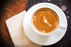 Hot coffee cup on wooden table. Top view. Royalty Free Stock Photo
