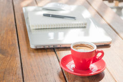 Hot coffee cup on wooden work station Royalty Free Stock Photos