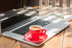 Hot coffee cup on wooden work station Royalty Free Stock Photo