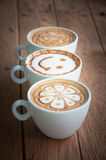 Hot coffee with decorate art on top Royalty Free Stock Photos