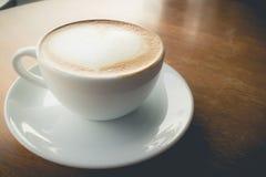 Hot coffee with foam milk Stock Photo