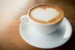 Hot coffee with foam milk Royalty Free Stock Photos