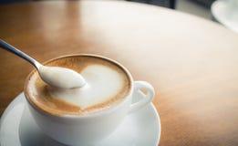 Hot coffee with foam milk Stock Photos