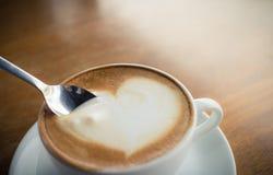Hot coffee with foam milk Stock Image