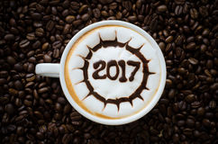 Hot coffee with foam milk art 2017 pattern Stock Photo