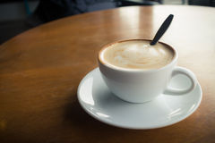 Hot coffee with foam milk Royalty Free Stock Photography