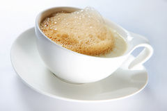 Hot coffee with froth Royalty Free Stock Photo