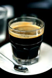 Hot coffee in glass. Dubbel espresso americano in glass Royalty Free Stock Photography