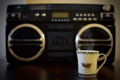 Hot coffee and music player Stock Images