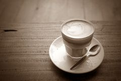 Hot coffee on grunge wood background Stock Photo