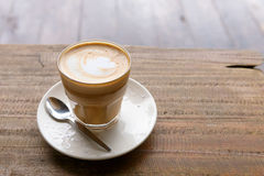 Hot coffee on grunge wood background Stock Images