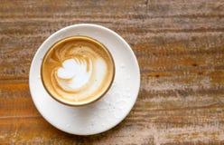 Hot coffee on grunge wood background Stock Photo