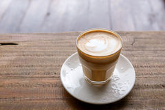 Hot coffee on grunge wood background Royalty Free Stock Images