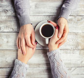 Hot coffee in the hands of a loved one. Royalty Free Stock Images
