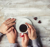 Hot coffee in the hands of a loved one. Royalty Free Stock Photo